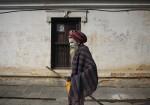 Hindu holy man, or sadhu, walks at premises of Pashupatinath Temple in Kathmandu
