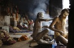 Hindu holy man, or sadhu, smears ashes on back of his friend at their ashram in Pashupatinath Temple in Kathmandu