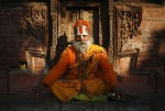 A Hindu holy man, or sadhu, rests in front of a temple in Kathmandu