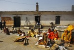 Hindu holy men, or sadhu, are seen as they rest at the premises of Pashupatinath Temple in Kathmandu