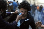 Egyptian protester washes the eyes of his companion, who suffered from the effects of tear gas in Tahrir Square in Cairo, Egypt, November 21, 2011. (Mohammed Hossam  AFP Getty Images)