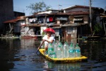 Local resident passes the drinking water on a makeshift raft in a flooded village in Malabone north of Manila, Philippines, September 29, 2011. (John Javellana  Reuters)