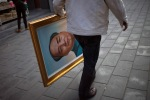 A man carries a portrait of late Chinese communist leader Mao Zedong at a flea market in Beijing, April 16, 2012. (Alexander F. Yuan  Associated Press)