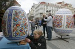 A woman paints a huge Easter egg on the Old Town Square in Prague. (© David W Cerny  Reuters)