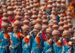 Indian schoolchildren perform a Rajasthan folk dance at the Republic Day parade in New Delhi, India, Wednesday, Jan. 26, 2011. The day marks the anniversary of India's adoption of a democratic constitution. (AP Photo/Gurinder Osan)