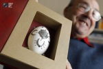 Jozsef Koszpek shows an egg, decorated with miniature metal horseshoes in Szekesfehervar, Hungary. (© Laszlo Balogh  Reuters)