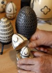 Jozsef Koszpek shows egg, decorated with tiny metallic shoes in accordance with the old Hungarian tradition in Szekesfehervar, Hungary. (© Laszlo Balogh  Reuters)