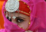A Kashmiri performer looks on during a R