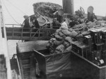 Loading mail bags and suitcases on the Titanic, April 11, 1912. (Fr Browne SJ Collection-UIGThe Bridgeman Art Library)
