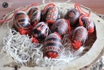 Painted Easter eggs lie on a tray in the Adlesici, Slovenia. (© Srdjan Zivulovic  Reuters)