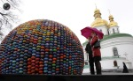 People are looking at a spherical sculpture made up of Easter eggs, near the Kiev-Pechersk Lavra in Kiev, Ukraine. (© Konstantin Chernichkin  Reuters)