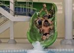 The North Korean youth rides a water slide at the pool of Kim Il Sung University in Pyongyang, North Korea, April 11, 2012. (Ng Han Guan  Associated Press)