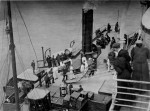Workers are immersed baggage on board the Titanic April 11, 1912. (Fr Browne SJ Collection-UIGThe Bridgeman Art Library)