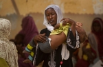 A woman with a child arrives at the hospital in Mao, Kanem regional capital, Chad, April 17, 2012