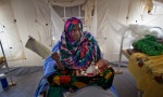 Mother fanning herself her 8-month old daughter Kubura Ali, who is not able to eat due to illness caused by malnutrition in intensive care at a hospital in the Ngurah Rai, Chad, April 18, 2012.