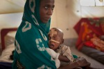Twenty Ashta Abdoulaye keeps on hand a year-old son, Ali Moussa, who takes medications from acute malnutrition through a nasal tube, April 19, 2012.