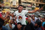 A protester shouts slogans during a protest against the presidential candidates, and Mohammed Mursi Ahmed Shafiq on Tahrir Square in Cairo. (SUHAIB SALEM  REUTERS)