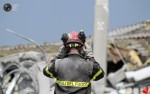Rescuer inspects the area near the building which was damaged in an earthquake in Medolle. (STEFANO RELLANDINI REUTERS)