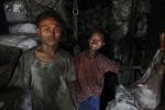 The boys sell coal to shop in Yangon. (DAMIR SAGOLJ  REUTERS)