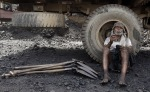Worker smokes after the loading of coal near the railway station Chiwaki in Allahabad in northern India. (JITENDRA PRAKASH  REUTERS)