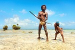 Father and son fishing with a bow and arrow - Rah Lava Island, Vanuatu, 2010