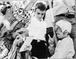 Christopher Wilding looks on as his mother, American actress Elizabeth Taylor, makes up her eyes for her role as Cleopatra