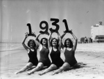 Girls on the beach in Santa Monica, California in swim suits showing the new year 1931.