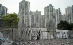 urban-headache-street-art-graffiti-jr-in-front-of-aprtment-complex1-800x500