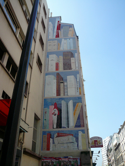 Faded mural in Paris, France.