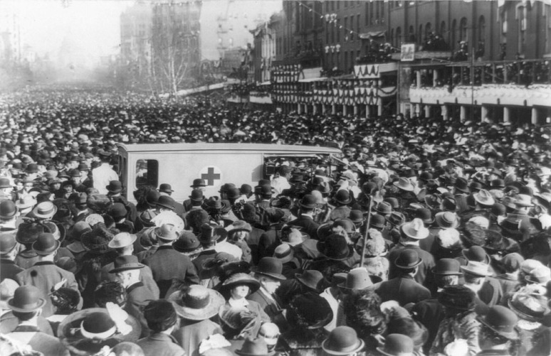 Crowd around an ambulance. Dozens of protesters were injured in the day during the march, March 3, 1913.