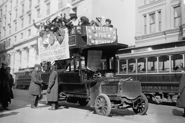Suffragettes riding on a bus in New York as part of the parade for women's suffrage. March 3, 1913